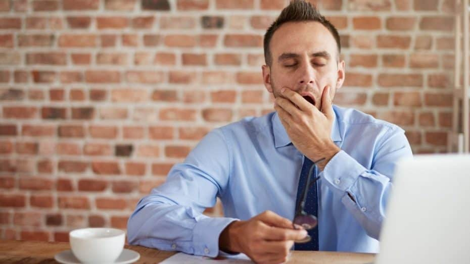 businessman in tie yawning