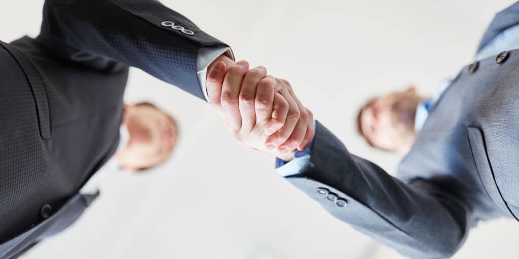businessmen handshake bottom view