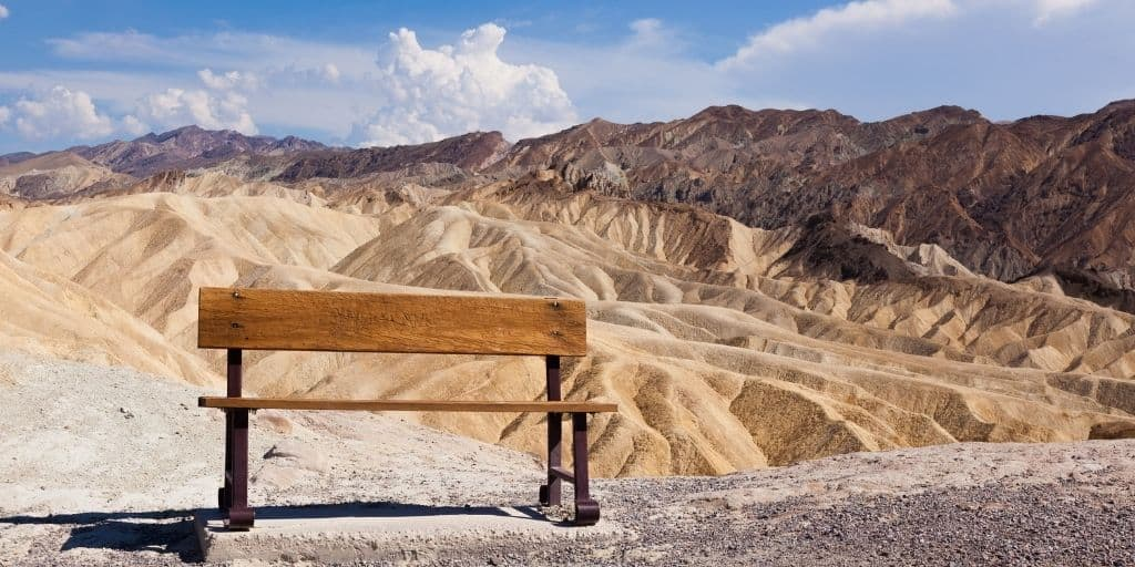 eroded ridges at death valley, bench in foreground