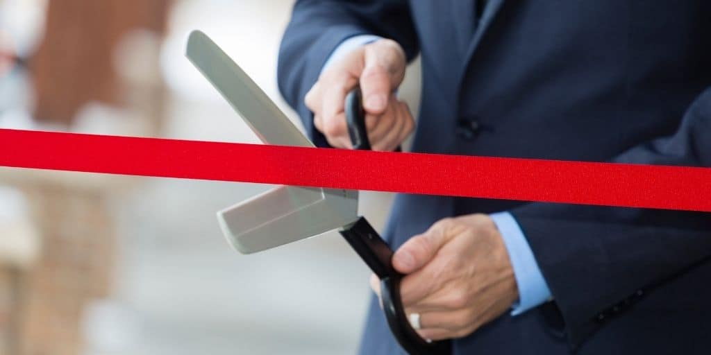 transitioning to full-time real estate investing cutting ribbon