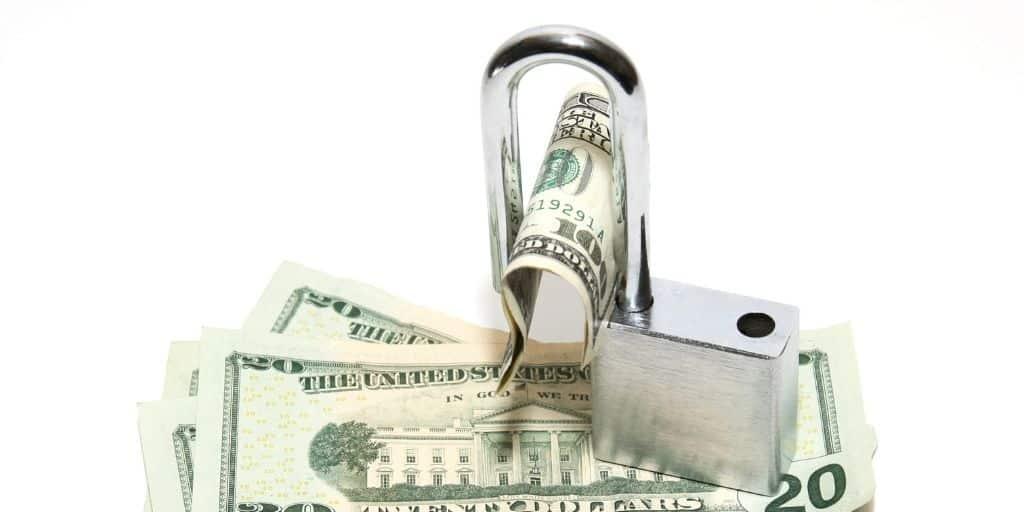 open padlock on top of 20-dollar bills